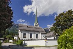 Stock Photo of Catholic parish church Wilder Kaiser or Wild Kaiser behind Scheffau am Wilden