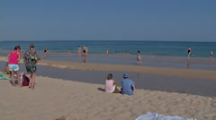 Late afternoon on the beach in the Algarve still some people in the water Stock Footage