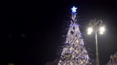 Stock Video Footage of Christmas tree lightning in the town, star twinkle