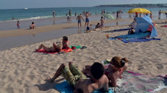 Beach in the Algarve with many people in the towel and child out of the water Stock Footage