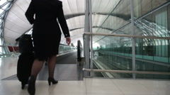 Airport travelator with flight crew & passengers - stock footage