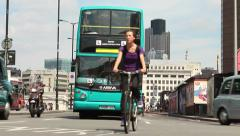 Taxis and buses drive towards camera at London Bridge Stock Footage