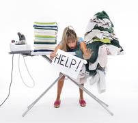 Woman behind an ironing board asks for help Stock Photos