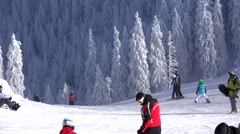 Tourists enjoy the snow, mountain resort ski slope, beautiful winter scenery - stock footage