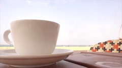 Cup of coffee near the ocean Stock Footage