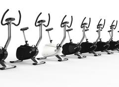 Row Of Stationary Bikes - one white Stock Illustration