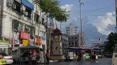 Food stalls and small clocktower,Kota Bharu,Kelantan,Malaysia Stock Footage