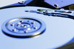 Close up inside of Harddrive (HDD) on white background - stock photo