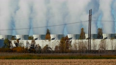 Power plant cooling towers venting steam into the atmosphere Stock Footage