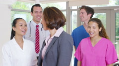 4K Portrait of smiling medical workers in modern hospital. Stock Footage