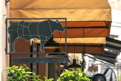 Georgia, Tbilisi - September, 2015: signboard with the picture of a cow near the Stock Photos