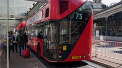 New Routemaster bus pulls into Victoria - stock footage