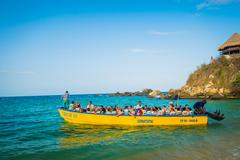 Boat with tourists in Tayrona National Park, Colombia Stock Photos