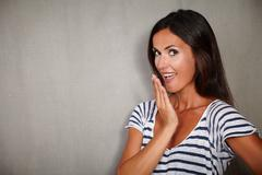 Brunette lady with straight hair looking surprised at camera - copy space Stock Photos