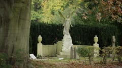 Angel grave stone, gothic cemetery, England, Europe Stock Footage