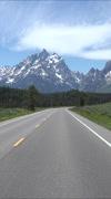 Drive POV beautiful Grand Teton Mountain range vertical HD Stock Footage