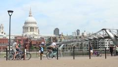 Cyclists and St Pauls Cathedral - stock footage