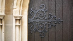 Chuch door detail (iron hinge), England, Europe Stock Footage