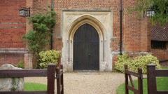 Red brick Church entrance, English Church, Europe Stock Footage