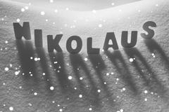 White Word Nikolaus Means St Nicholas On Snow, Snowflakes - stock photo