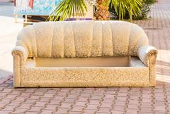 Old abandoned couch dumped on the street Stock Photos