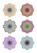 Set of geometric circle lace ornaments in different color variants. Symmetric Stock Illustration