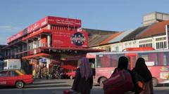 Women crossing road to bus station,Kota Bharu,Kelantan,Malaysia Stock Footage