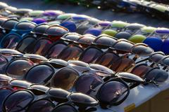 Different modern sunglasses close up on table - stock photo