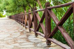 Woody fence in park - stock photo