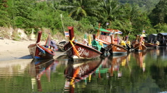 Stock Video Footage of Colorful Boats in Small Village in Phuket Thailand