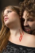 vampire bites girl - stock photo
