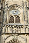 Tower clock of St. Vitus Cathedral in Prague, Czech Republic. - stock photo