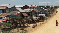 Stock Video Footage of Shacks in the Cambodian Country Side / Farm Lands