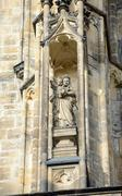 Sculpture above Golden Gate of St. Vitus cathedral, Prague. - stock photo