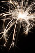 Sparkler or Bengal fire - scattering sparks Stock Photos