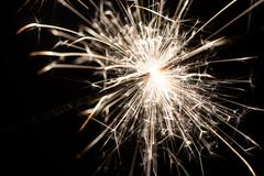 sparkler or Bengal fire - scattering sparks - stock photo