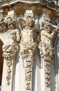 Sculpture of satyrs as atlantes under Rampart pavilion, Zwinger, Dresden. - stock photo