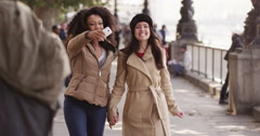 Girlfriends taking selfies together outdoors. Shot on RED Epic. - stock footage