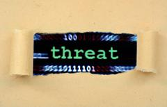 Stock Illustration of Threat text on ripped paper