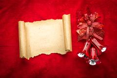 Christmas vintage scroll on red background Stock Photos