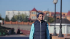 Young sportsmen dressed in sportswear workout in the fresh air - stock footage