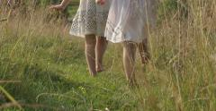 The bare feet of a child walking in the grass Stock Footage