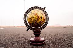 Globe Earth on an Asphalt Street - stock photo