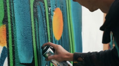 Graffiti artist drawing on the wall, close up Stock Footage