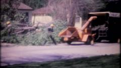 2635 - tree service clears fallen tree from neighborhood-vintage film home movie Stock Footage