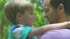 4K Happy affectionate father & son spending time outdoors in the woods Stock Footage
