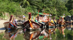 Stock Video Footage of Zoom Colorful Boats in Small Village in Phuket Thailand