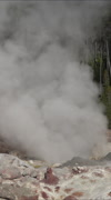 Small eruption Steamboat Geyser Norris Basin Yellowstone fast vertical HD Stock Footage