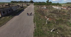 Aerial drone scene of abandoned, destructed town. Camera slowly moves laterally Stock Footage