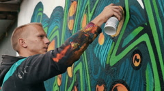 Graffiti artist drawing on the wall Stock Footage